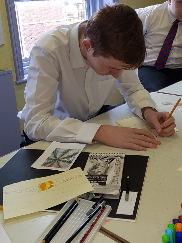 A year 10 student works towards his Arts Award qualification